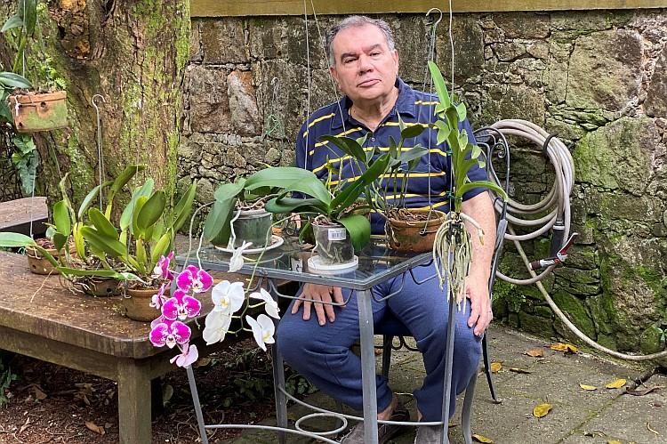 Marcelino Guedes Gomes together with his orchids