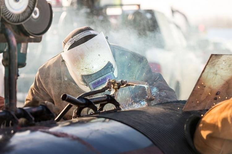 A pipeline welder works on an extension of the NGTL System, in Northern Alberta, Canada (Copyright: TransCanada)