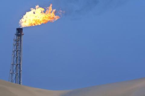 A flare stack burning off excess gas (Copyright by Shutterstock/Darren Baker)