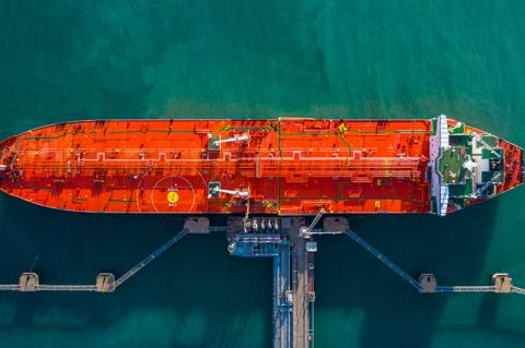 A tanker ship photographed from the air being unloaded in port (copyright by Shutterstock/Avigator Fortuner)