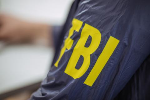 FBI agent wearing FBI uniform (copyright by Shutterstock / Dzelat)