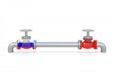 Pipe line and valves (faucets) with national flags of Russia and China (copyright by Shutterstock/Aksabir)