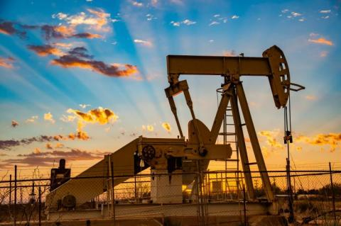 Pump sockets for the Permian basin at sunset (Copyright by Shutterstock/Mikki Shortes)