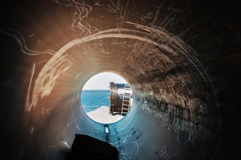 View of the sea and the end of a pipeline from inside of a pipeline (copyright by Adobe Stock/Luka)