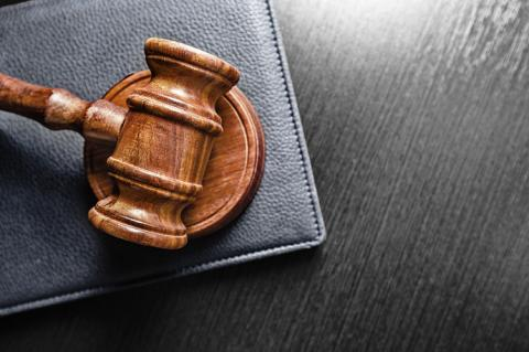 Judge's gavel on the table (copyright by Shutterstock/FabrikaSimf)