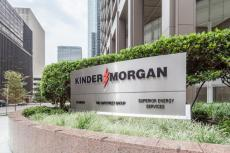Sign of Kinder Morgan at Company headquarters in Houston, US (copyright by Shutterstock/JHVEPhoto)
