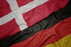 Waving flags of Denmark and Germany (copyright by Shutterstock/esfera)